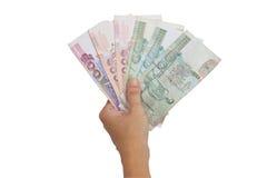 Thailändische Banknoten in der Hand. Lizenzfreie Stockfotos