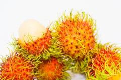 Thailändische Frucht, Rambutan auf weißem Hintergrund Stockfotos