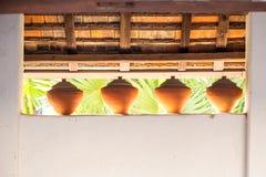 Thailändische gebackener Lehm des Glases Antike Lizenzfreie Stockfotografie
