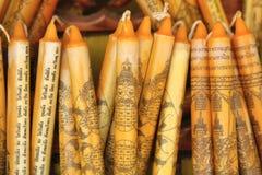 Thailändische gelbe Kerzen Lizenzfreie Stockfotografie
