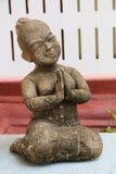 Thailändische Jungenstatue Stockbilder