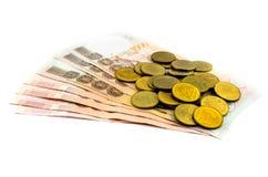 Thailändische Münze und Banknote Stockfotos