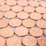 Thailändische Münzen auf weißem Hintergrund, der Minimalwert des Baht Lizenzfreies Stockbild