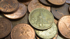 Thailändische Münzen, 50 und 25 Satang0 5 und 0 Baht 25 Stockfotos