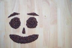 Thailändische schwarze Jasminreis Reisbeeren-Lächelnform Stockbild