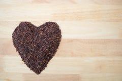 Thailändischer schwarzer Jasminreis u. x28; Reis berry& x29; Herzform Stockbild