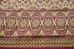Thailändischer silk Holzschuhhintergrund Lizenzfreie Stockfotos