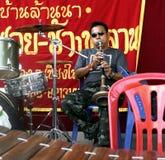 Thailändischer Straßenmusiker Stockbild