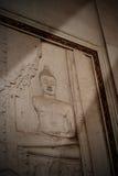 Thailändischer Tempel Buddhas der alten Wand über thailändische Geschichte stockfotografie