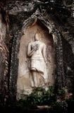 Thailändischer Tempel Buddhas der alten Wand über thailändische Geschichte stockfotos