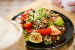 Thailändischer würziger Herzmuschel-Salat Yum Hoi Krang Stockfotografie