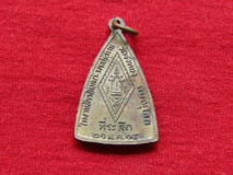 Thailändisches Amulett, Münzenrückseite Stockbilder