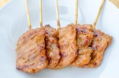 Thailändisches Art BBQ gegrilltes Schweinefleisch oder MOO-Klingeln stockfotos