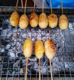 Thailändisches Lebensmittel, gegrillter klebriger Reis mit Ei Lizenzfreie Stockbilder