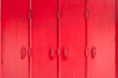 Thailändsk konst på den röda väggen Arkivbilder