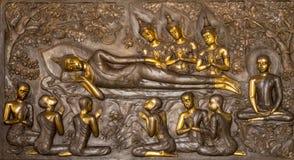 Thailändsk konststuckatur på väggen av kyrkan Arkivfoto