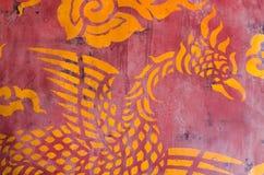 Thailändsk målarfärg på väggen Arkivbild