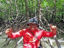 Thailändsk man i djungel Fotografering för Bildbyråer