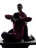 Thailändsk massagesilhouette Royaltyfri Foto