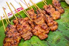 Thailändsk mat för grisköttgrillfestgata Royaltyfri Bild