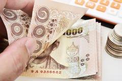 Thailändsk sedel av 1000 baht bakgrund Arkivfoto