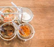 Thailändsk smaktillsats för nudel med fyra exponeringsglas av ingrediensen Fotografering för Bildbyråer