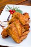 Thailändsk stil, grillade fega vingar Arkivfoto