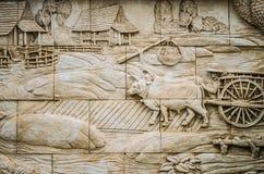 Thailändsk stuckatur för infödd kultur på tempelväggen Arkivfoto
