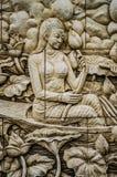 Thailändsk stuckatur för infödd kultur på tempelväggen Fotografering för Bildbyråer