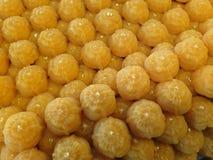 Thailändsk sweetmeat som göras av äggula och socker arkivfoto