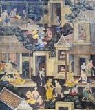 Thailändsk vägg- målning på tempelväggen Arkivfoto