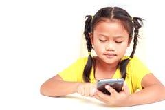 Thailändska barn som isoleras på vit bakgrund Arkivbild