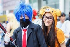 Thailändska cosplayers klär som teckenen från tecknad film och leken i den Japan festaen i Bangkok Fotografering för Bildbyråer