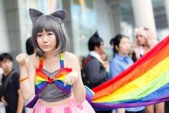 Thailändska cosplayers klär som teckenen från tecknad film och leken i den Japan festaen i Bangkok Royaltyfri Bild