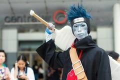 Thailändska cosplayers klär som teckenen från tecknad film och leken i den Japan festaen i Bangkok Arkivfoton
