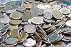Thailändska myntpengar för att handla utbyte Royaltyfri Bild