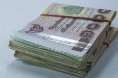 Thailändska pengar, 1000 bahtsedlar på vit bakgrund Royaltyfri Bild