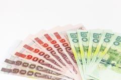 Thailändska pengar består av 20, 100, bad 1000 Royaltyfri Foto