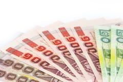 Thailändska pengar består av 20, 100, bad 1000 Royaltyfri Fotografi