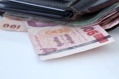 Thailändska pengar i plånbok Fotografering för Bildbyråer