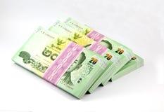 Thailändska pengar på vit bakgrund Arkivfoto