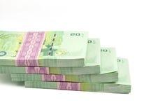 Thailändska pengar på vit bakgrund Arkivbild