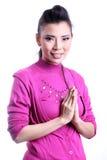 Thailändskt kvinnavälkomnandeuttryck Sawasdee Fotografering för Bildbyråer