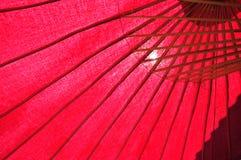 Thailändskt rött en umbralla med hålet Royaltyfri Bild
