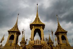 Royal Crematorium of King Rama Nine of Thailand. Thail Royal Crematorium for royal funeral of His Majesty King Bhumibol Adulyadej. With dark cloudy sky in Royalty Free Stock Photos