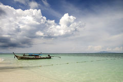 Thailand. Boat isolated on a clear water, Bamboo Island, Thailand Royalty Free Stock Images