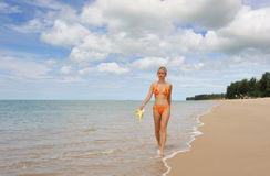 Thailand. Andaman sea. Beautiful girl in swimsuit. Thailand. Andaman sea. Ko Kho Khao island. Beautiful girl in orange colorful swimsuit walking on the desert stock photos