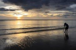 Thailand. Andaman sea. Ko Kho Khao island. Beach. Photographer is taking photos at a sunset Royalty Free Stock Photos