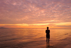 Thailand. Andaman sea. Phi Phi island. Alone girl. Thailand. Andaman sea. Phi Phi island. Magic sunrise landscape and a silhouette of alone girl royalty free stock images