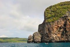 Thailand. Andaman sea. Phi Phi island. Canoe. Is sailing near rocky coast Stock Images